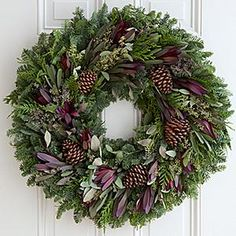 Rustic Natural Protea Wreath - Bring the natural beauty of the outdoors in. Our beautiful protea wreath is a warm way to welcome cooler temperature and snowy days. Adorned with five natural Ponderosa pine cones, and 18 protea blooms, this fragrant beauty is a long lasting gift sure to be cherished.