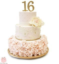 This cake was created for a sweet 16 this weekend and included a combination of ivory peonies, quilted blush with piped gold dots, lace applique and large blush ruffle. Colors included light pink and white along with our signature pink velvet cake with vanilla buttercream.