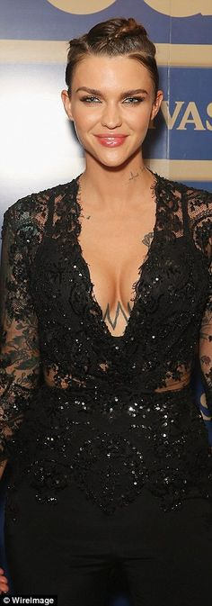 Busty display: The model-turned-actress showed off her tattoos and her cleavage in her lace top, adding some edge to the elegant ensemble with braids in her hair