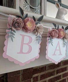 Personalize this beautiful, floral banner with a name or wording of your choice. It makes a unique gift for a mom-to-be and her new babys nursery. Or hang it at a bridal shower for the Future Mrs. Each pennant features three beautiful, hand-crafted paper flowers.  --The banner is priced by the