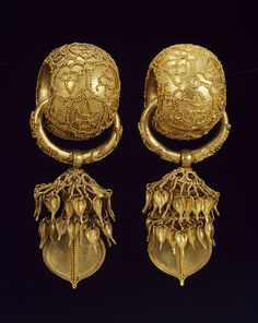 These thick gold earrings were found in Bubuchong (Tomb of Husband and Wife) in Bomun-dong, Gyeongju, Korea. They are among the most elaborate and magnificent gold earrings excavated from the Silla tombs, circa 6th century, Silla period.