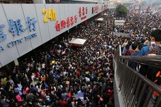 """Passengers wait to get into the crowded Zhengzhou Railway Station on the first day of """"the Golden Week,"""" a holiday that celebrates the founding of the People's Republic of China. Zhengzhou, Chongqing, Wuhan, Shanghai, China Tourism, Golden Week, Real Estate Prices, Photos 2016, Great Wall Of China"""