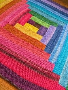 Rainbow knitted rug... colourful...