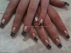 Light nude with black flower freehand nail art