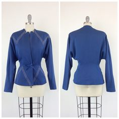 Stunning bright cobalt blue jacket from the 40s. Made out of medium weight wool and fully lined with satin fabric. Unique neckline with studding at the shoulders and waist (highlighting some hidden pockets) Adjustable bow waist tie. Perfect year round!  | c o n d i t i o n |  great - one light spot on the bodice. see last photo for reference. priced accordingly.  | m e a s u r e m e n t s |  will fit a modern day size 10 bust - 40 to 44 inches waist - 31 inches shoulder to waist - 17 inches…