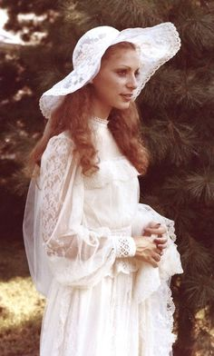 Lovely Ivory Lace Vintage 1970s Wedding Gown with matching Hat and Veil.