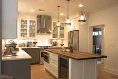 Platinum Kitchens: White upper cabinets with gray base cabinets
