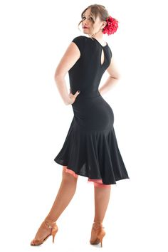 This lovely latin dancing dress is a must have. Features beautiful full skirt with red crinoline hemline. Made from stretch crepe. Model is wearing size S/M