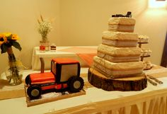 "L.a. and Josh Morgan's 4 tier burlap and lace rustic square wedding cake and 3D Case IH Tractor grooms cake ""pulling"" the wedding cake! All buttercream and candy clay! All edible, no fondant!  https://www.facebook.com/angelas.cakes2011"