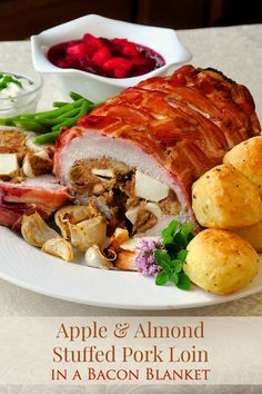 Apple Almond Stuffed Pork Loin in a Bacon Blanket is a veritable Pork-a-pollooza! A very nice combination of flavours and textures in the stuffing + LOOK AT ALL THAT BACON!