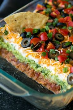 My favorite recipe for Bean Dip! Packed with flavor and always a crowd pleaser. Perfect game day food or party snack. My favorite recipe for Bean Dip! Packed with flavor and always a crowd pleaser. Perfect game day food or party snack. 7 Layer Bean Dip, Layered Bean Dip, Seven Layer Dip, 7 Layer Taco Dip, 7 Layer Dip Recipe With Meat, Appetizers For A Crowd, Appetizer Recipes, Recipes Dinner, Dip Appetizers