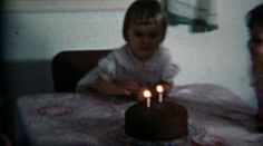 1960: Girls blow out birthday candles pig out on chocolate cake. http://www.pond5.com/stock-footage/57295996?ref=StockFilm keywords:girl, birthday, candle, blowout, wish, age, 2, party, family, cute, surprise, eat, food, cake, chocolate, 1960, 8mm, film, old, home movie, vintage, retro, archive, nostalgia, memories, throwback, Americana, documentary, editorial, historic, preserve, restore, real, classic, era, priceless, generation, timeless, humanity, innocent, viral, national, advertise…