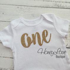 One - gold glitter shirt bodysuit, First Birthday, 1st Cake Smash baby girl infant toddler, sparkly sparkle glittery, half birthday number 1 by HoneyLoveBoutique