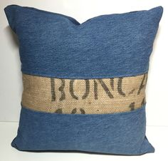 This decorative denim pillow cover is a patchwork of upcycled denim and upcycled coffee sack burlap. The burlap has a black typography on it. The back of the pillow is an envelope style closure in a dark blue brushed corduroy. It is super soft to the touch. It would look great in a boho chic home, a farmhouse or beach cottage! This listing is for a pillow cover only. Pillow form is not included. Id suggest using a 16 x 16 form as it will fill out the pillow cover nicely. Handmade in my…