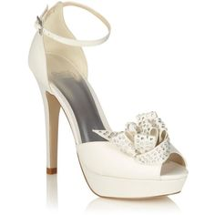 Ivory high heel platform bridal shoes with corsage trim (35) found on Polyvore