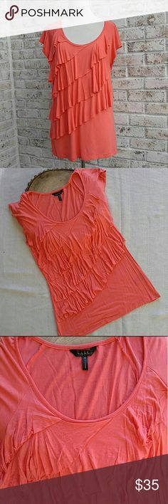 Nicole Miller New York Ruffled Shirt A pretty shade of coral and super soft and stretchy! Gently used and no flaws! Thanks for looking! Nicole Miller Tops Tees - Short Sleeve