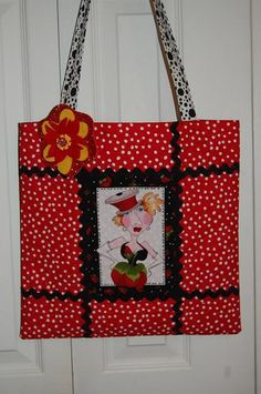 Made this on the weekend. I named this tote Red Thread Head Lady! Lol! She has a spool of thread for a hat.