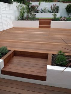 Keeping it simple but very stylish - multi level contemporary garden, using white to cover a multitude of surfaces and unite the look, hip or what.