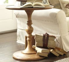 Pretty!  Just large enough for a lamp and a glass of wine.      Newberry Pedestal Side Table | Pottery Barn