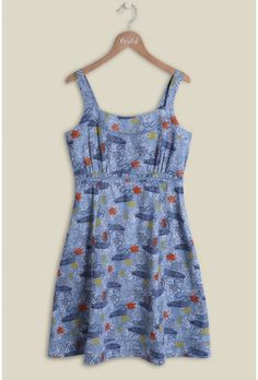 A simply stunning summer staple. Our Mystical Seabed Sundress features a print inspired by the famous 'row row row your boat' in an array of rich colours. The strappy dress falls just above the knees and features lace detailing around the neckline and the waistband. Soon to be your go-to summer sundress!  100% cotton  This dress is 40 ins / 101 cms from the highest point to the hem in a size 12.