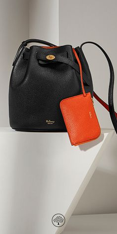 Shop the Abbey family at Mulberry.com. The Abbey is a traditional 'bucket bag' with drawstring detailing, contrast lining and available in a range of eye-catching and iconic leather finishes. The Abbey also features the iconic postman's lock as a nod to Mulberry's heritage DNA, securing a simple belt closure on a timeless, easy to wear style.