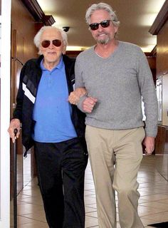 Kirk Douglas, 97, and son Michael, 69, are in high spirits after lunch