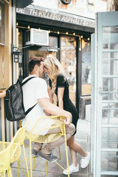 Barefoot Blonde Amber and David kissy kissy in chair