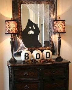 I do the BOO every year on pumpkins for outside at my and my daughters homes but this is cute and really love the mirror ghost.