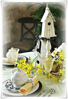 White birdhouses became the centerpiece and the yellow really pops against the black and white.