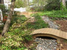 Bridge over rock or pebble garden.