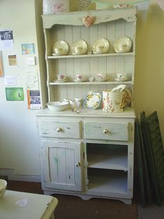Gorgeous really shabby kitchen dresser finished in cream with hints of green. £195