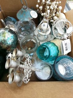 some of the metal and glass décor used for table decorations