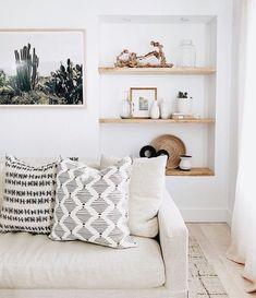 Large cactus art over couch. Natural interior design. White oak floors.