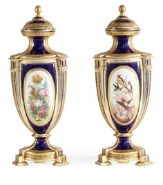 A PAIR OF COALPORT BLUE-GROUND VASES AND COVERS CIRCA 1870.