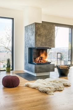 The 70 Best Modern Fireplace Design Ideas - Luxury Interior Fireplace Hearth, Home Fireplace, Living Room With Fireplace, Fireplace Ideas, 3 Sided Fireplace, Fireplace Inserts, Hanging Fireplace, Fireplace Pictures, Farmhouse Fireplace