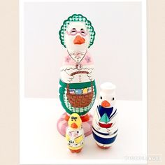 Spring Mother Goose & Babies Wooden Nesting Doll Very cute vintage 90's nesting doll set featuring mother goose and her ducklings. Mother goose holds a basket of eggs and wears a bonnet. Sailor boy duckling and flower girl duckling. Last doll holds mini plastic eggs (not pictured). Uniquely shaped and rare doll. Made in China, not Russia. Some paint wear around openings. Vintage Other