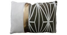 This bold, patchwork pillow, featuring a modern, graphic print fabric, metallic bronze leather, and beige ultrasuede fabric, is finished with a solid cream back, a knife edge, and zipper closure. A...
