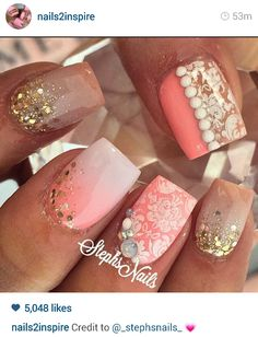 Salmon pink detailed nails.