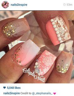 Salmon pink detailed nails.