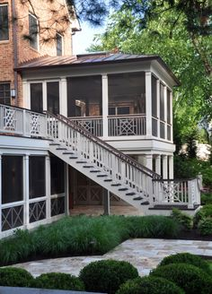 Screened porch with chippendale railing and metal roof.