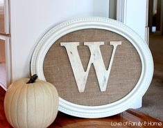 DIY... cool frame, burlap, and an antiqued-painted wood letter = awesomesauce! I love this :)