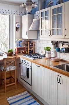 This is how the kitchen in the house I grew up should look like. Country yet modern
