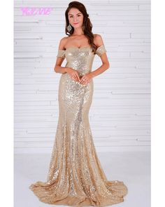 Make an everlasting impression with our elegant 'Madeline' gown. This off-the-shoulder dress is adorned in gold sequins with an elegant trail to form a figure-flattering silhouette. Flawless ensemble for attending weddings, prom and galas. Satin Dresses, Sparkly Dresses, Formal Dresses, Formal Prom, Formal Wear, Stunning Prom Dresses, Backless Gown, Sequin Gown, Designer Gowns