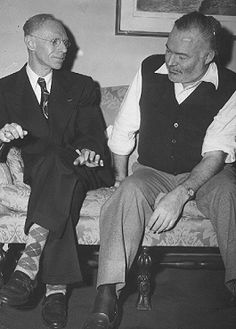 Today in 1961, American author Ernest Hemingway dies. He is shown on the right with Charles Adler, Jr. in 1949.