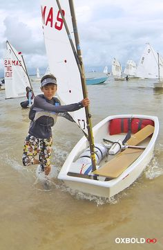 Optimist sailor back from race during Malaysia Independence Day Open Regatta 2014.