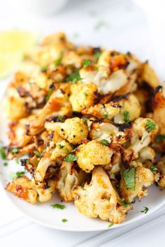 Miso Roasted Cauliflower - This umami packed buttery side dish is delicious, yet totally vegan + GF| platingsandpairings.com