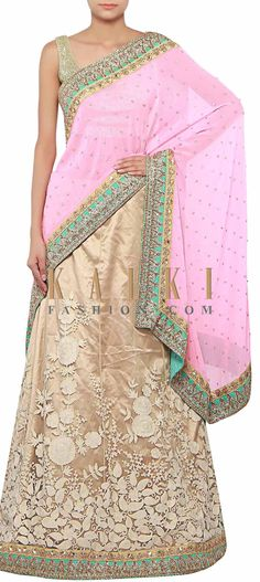 Buy Online from the link below. We ship worldwide (Free Shipping over US$100) http://www.kalkifashion.com/half-and-half-saree-in-beige-and-pink-adorn-in-thread-and-pearl-embroidery-only-on-kalki.html