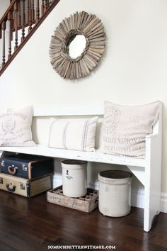 Gorgeous home tour of So Much Better with Age - love this bench and driftwood mirror eclecticallyvintage.com