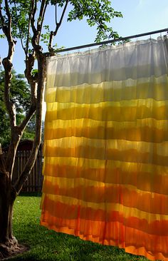 DIY Anthropologie style shower curtain.  Not sure I would use it as a shower curtain, but this would also make great curtains!
