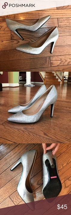 Silver Glitter Heels size 7 Isaac Mizrahi Silver Sparkly Heels size 7. Worn twice. Great condition. Has a scratch on the right heel (pictured) Isaac Mizrahi Shoes Heels